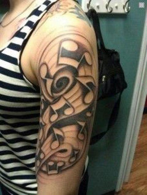 Tatuajes de Notas Musicales e Instrumentos 38