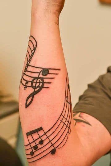 Tatuajes de Notas Musicales e Instrumentos 27